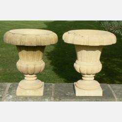 Pair of Carved Limestone Urns