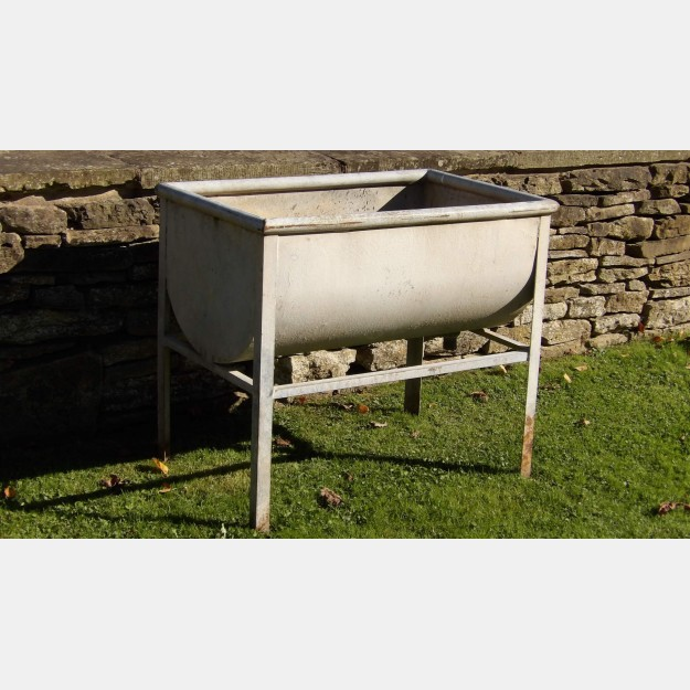 A vintage galvanised trough on stand