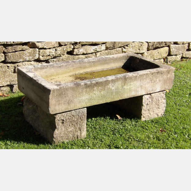 Old stone sink on blocks
