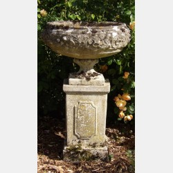 A Weathered Garden Urn on Plinth