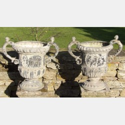 Pair of antique lead urns