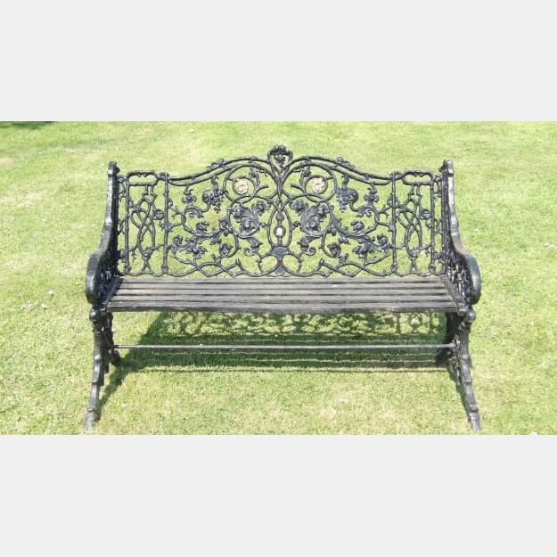 Face on view of vintage cast-iron bench