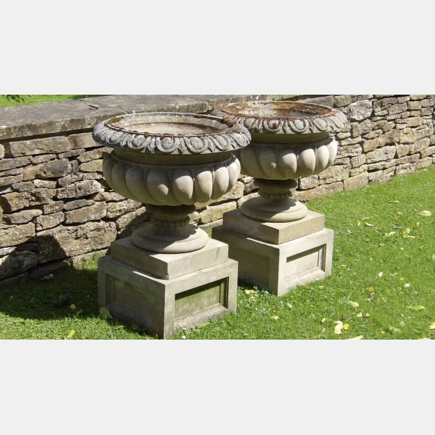A Pair of Weathered Haddonstone Urns