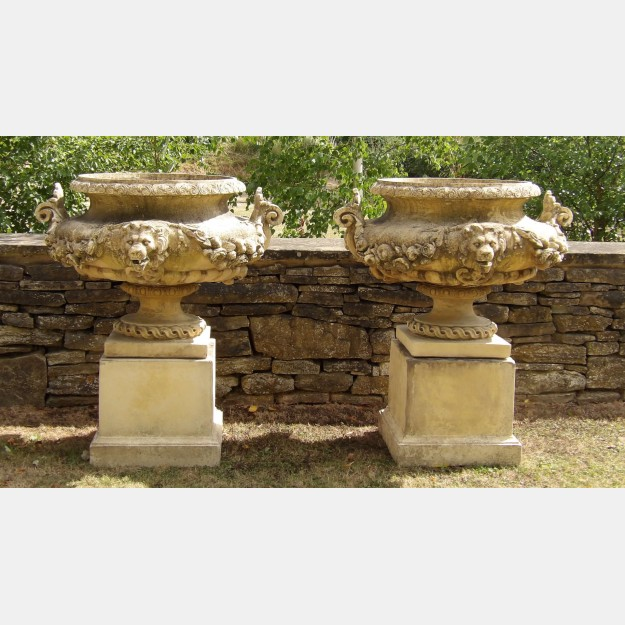 Pair of Large Weathered Urns