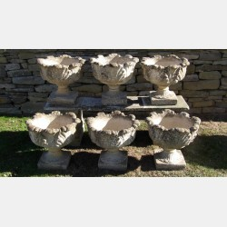 A set of six vintage garden urns