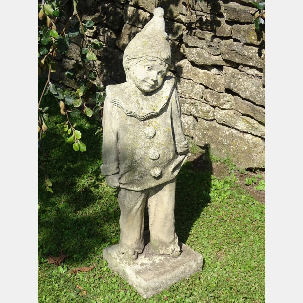 Weathered Clown Statue