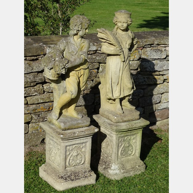 Pair Weathered Garden Statues